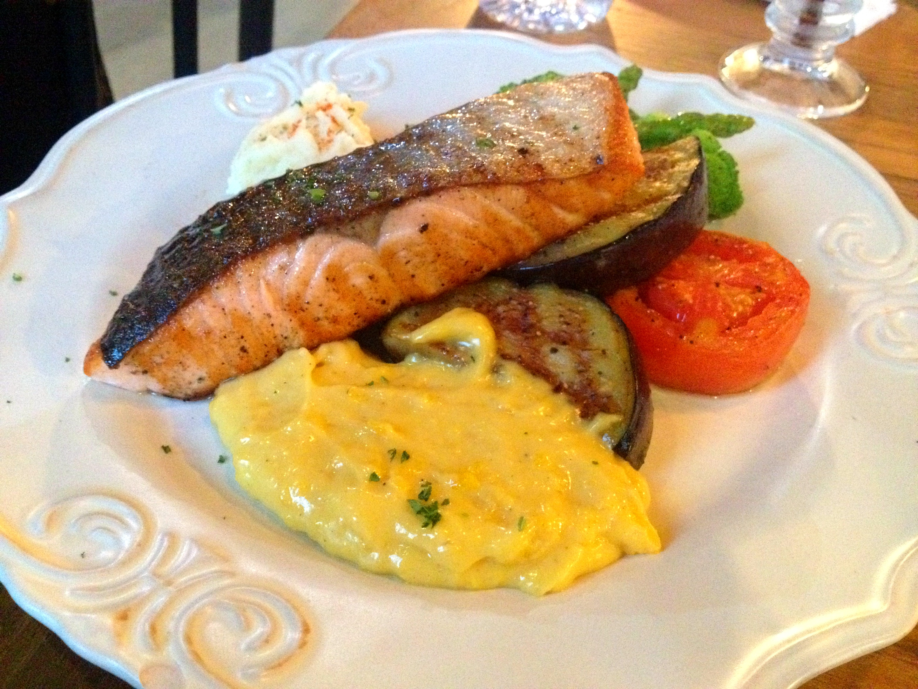 Salmon Steak Served With Mashed Potatoes And Side Vegetables At B Story Café Restaurant