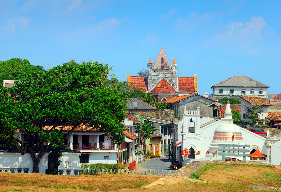 168713126_Beautiful scenery of ancient Dutch Galle Fort (UNESCO World Heritage Site) with Christian church and Buddhist stupa - view from fortification wall, southwest coast of Sri Lanka